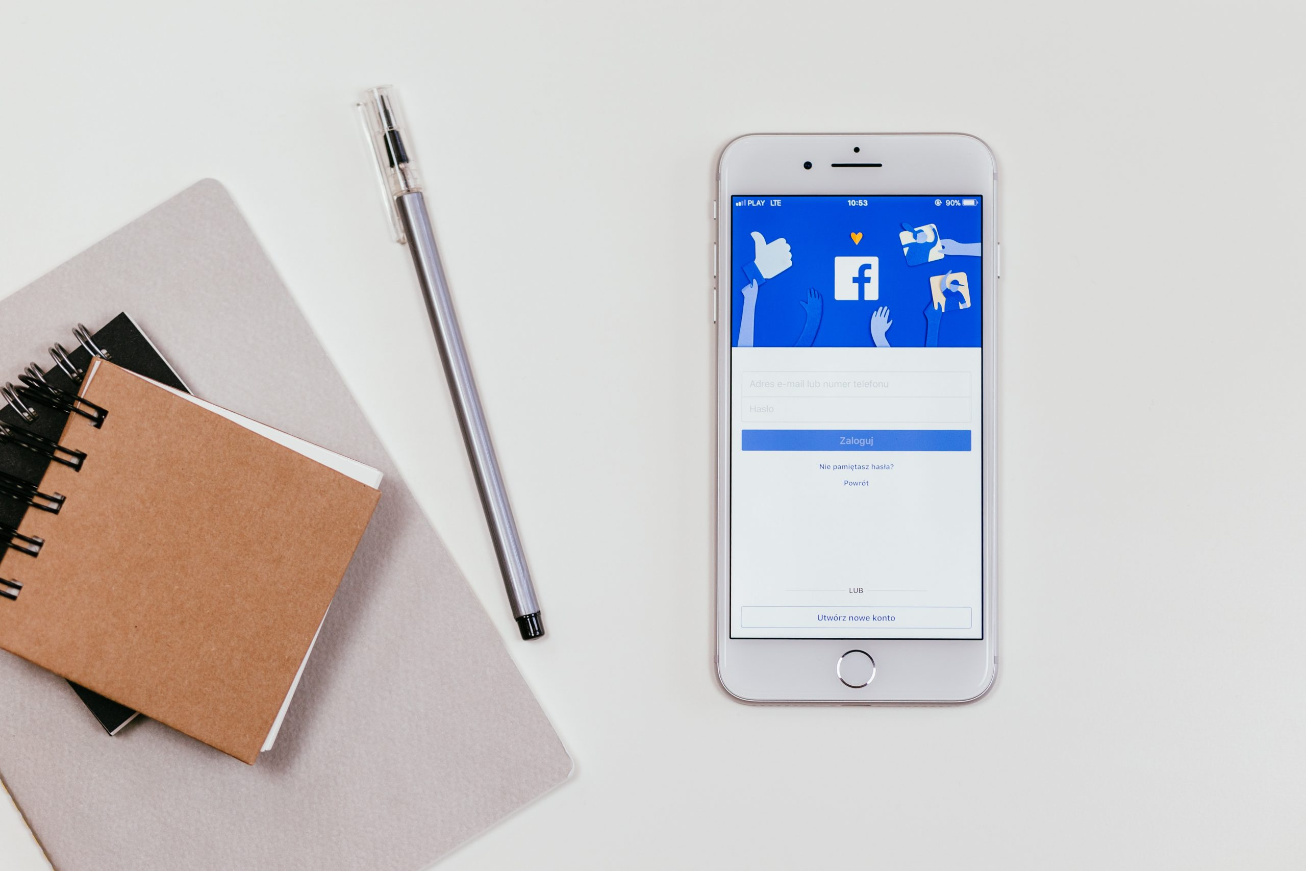 notepad with phone on Facebook